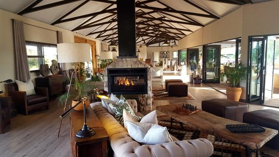 Old Drift Lodge, Victoria Falls - Old Drift Lodge, inside main area Lounge and Fire Place