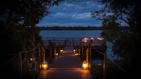 Old Drift Lodge, Victoria Falls - Old Drift Lodge, Jetty & Private Dinner set up.
