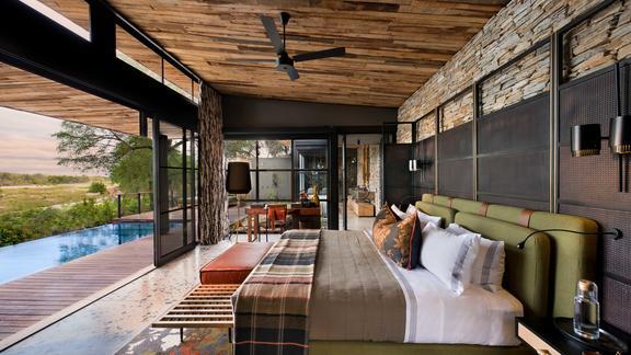 andBeyond Tengile River Lodge - Guide suite bedroom