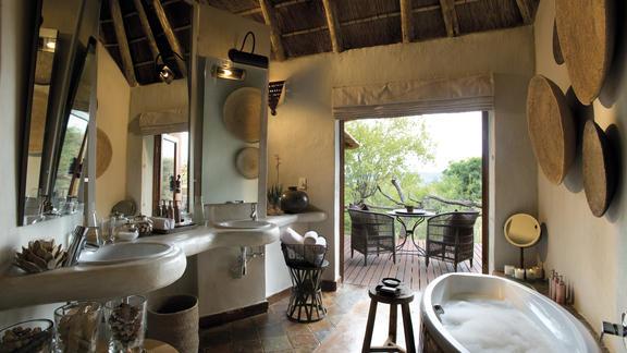 En-suite bathroom leading to outdoor shower -