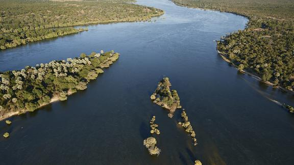 Victoria Falls River Lodge - The spray of the famous Victoria Falls - seen in the distance