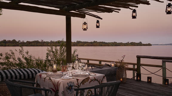 Victoria Falls River Lodge - Luxury Tented Suites - A romantic dinner on the jetty